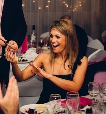 Wedding magician Dave Jones entertains partygoer